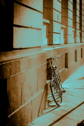 Bicycle against wall in building