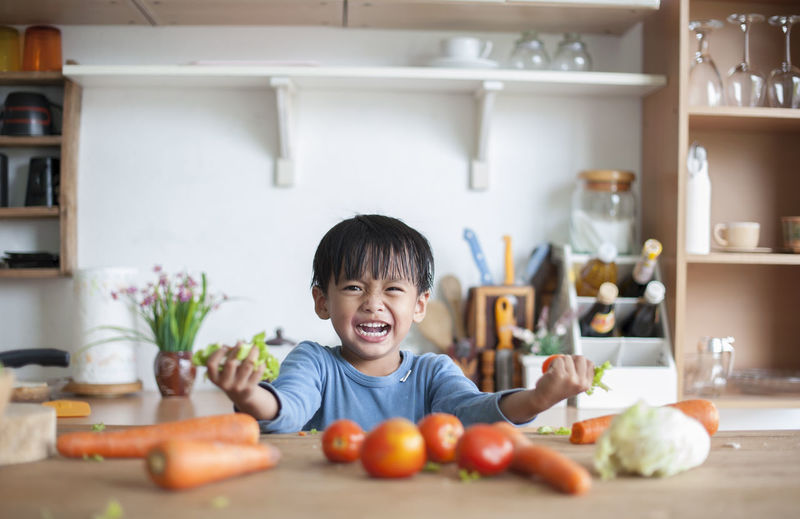 Boys Child Childhood Domestic Kitchen Domestic Life Domestic Room Food Food And Drink Front View Happiness Healthy Eating Home Indoors  Innocence Kitchen Lifestyles Men One Person Portrait Preparation  Preparing Food Smiling Wellbeing