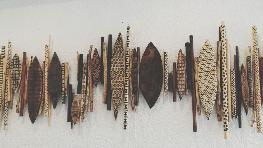 Wooden antique collection on wall