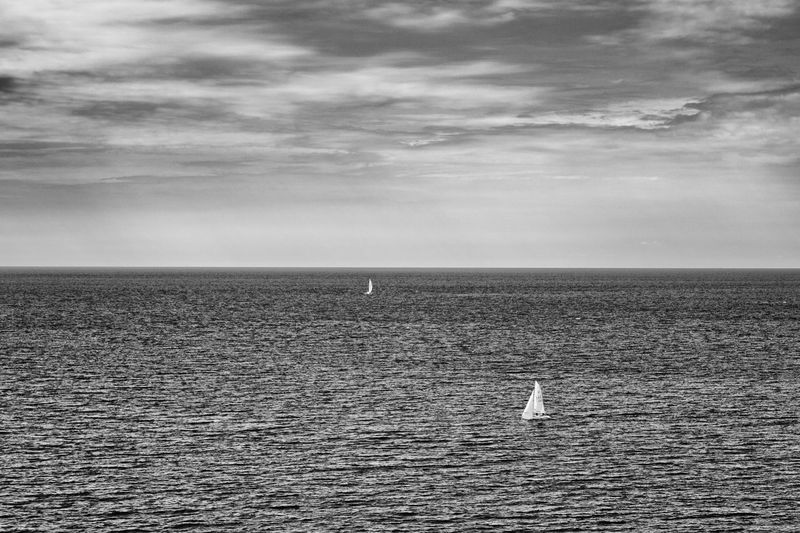 Sailboat on the ocean - Hidden Gems  Exceptional Photographs EyeEm Best Edits EyeEm Best Shots - Black + White EyeEm Masterclass The Week Of Eyeem Idyllic Sky Sea Calm Non-urban Scene Horizon Over Water Ocean Seascape Tranquil Scene First Eyeem Photo Coastline Black And White Scenics Tranquility Sea And Sky Remote Cloud - Sky Cloud Sea View Live For The Story The Great Outdoors - 2017 EyeEm Awards