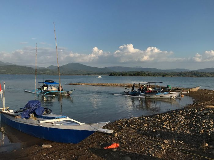 a peacefull place Fisherman Peaceful View Wonderful Indonesia Wonderful Simple Water Nautical Vessel Transportation Mode Of Transportation Sky Sea Nature Day Beach Land Moored Mountain Sunlight Beauty In Nature Cloud - Sky Scenics - Nature Incidental People Outdoors Tranquility Sailboat