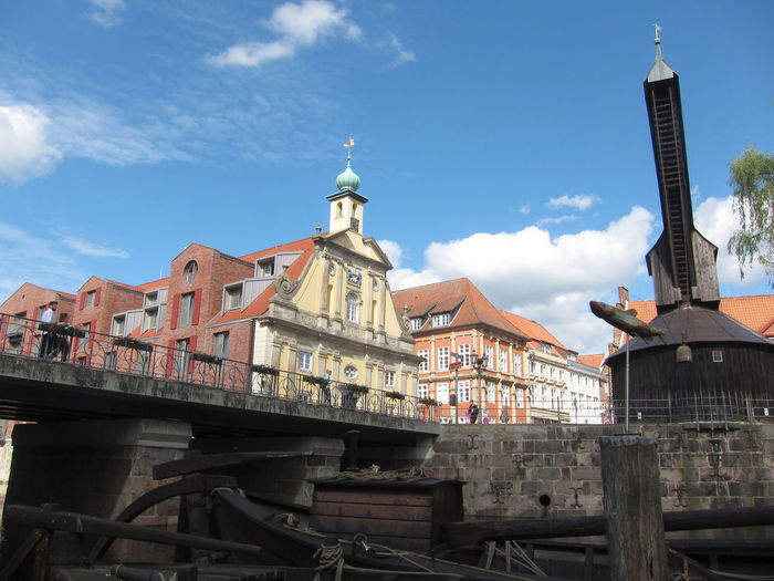 Functional Harbour Crane with pedal wheel from 1797 at the Fish Market in the water district of the historic Old Town of Lüneburg - Lower Saxony - Northern Germany - Funktionstüchtiger Hafenkran mit Tretrad von 1797 am Fischmarkt im Wasserviertel der historischen Altstadt von Lüneburg - Niedersachsen - Norddeutschland Deutschland; Germany; Germans; In; Norddeutschland; Nord-Deutschland; Norddeutschlands; North Germany; Niedersachsen; Niedersachsens; Ort; Stadt; Hansestadt; Hansestädte; Old; Town; Lower Saxony; Lüneburg; Lueneburg; Lüneburger; Lüneburgs; Altstadt; Old T Architecture Building Exterior Built Structure City Cloud - Sky Day History Low Angle View No People Outdoors Sky Travel Destinations Lüneburger Altstadt Luneburg Historic Old Town Travel Eyeem Travel Lüneburg-Bilder Lüneburg-Fotos