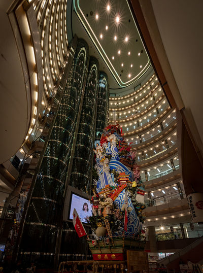 Yamakasa The Architect - 2019 EyeEm Awards Low Angle View Architecture Indoors  Illuminated Christmas Built Structure Staircase Decoration christmas tree Celebration Steps And Staircases Night Holiday Adult Lighting Equipment Arts Culture And Entertainment People Men Real People Leisure Activity