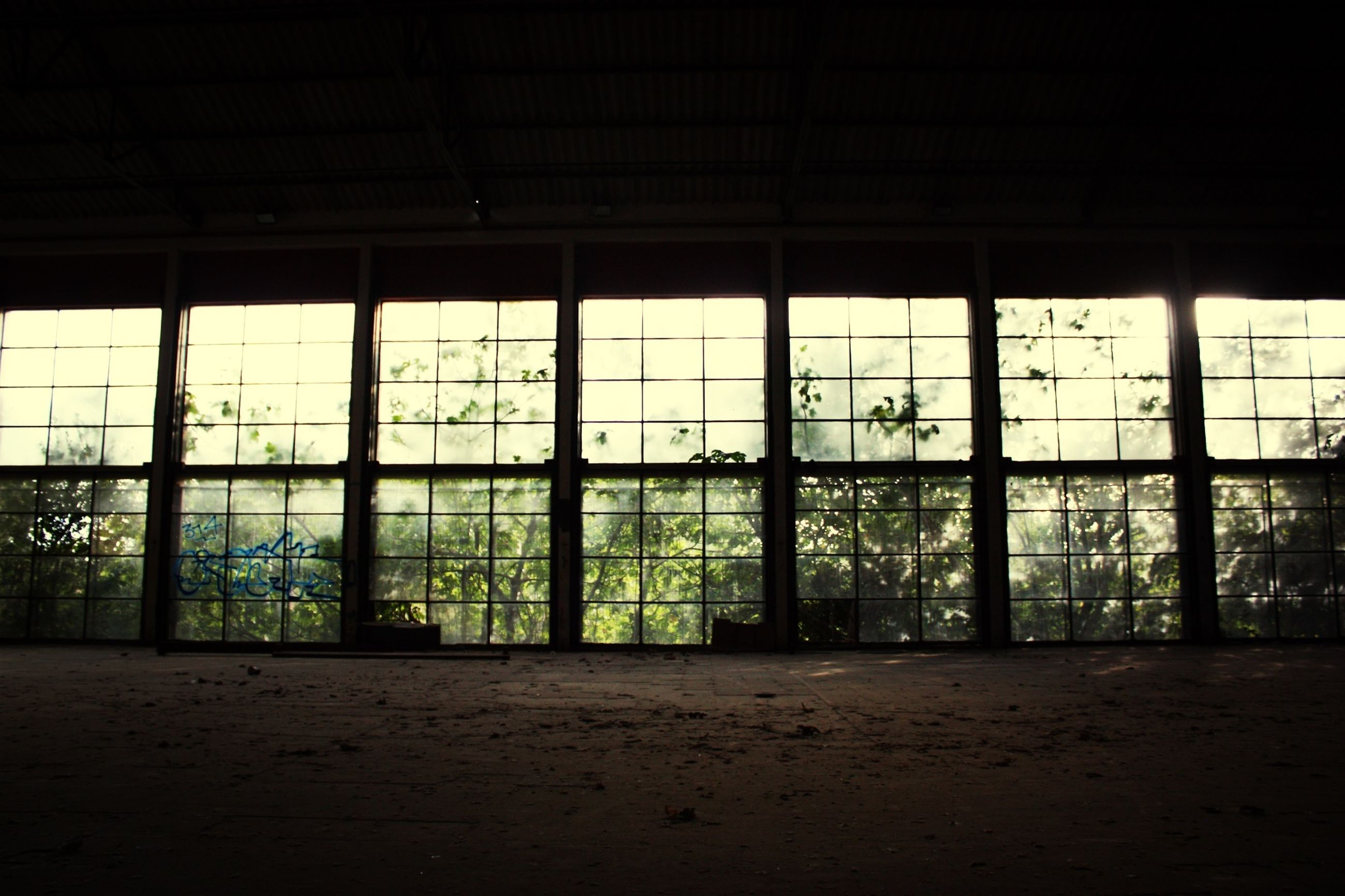 indoors, window, architecture, built structure, glass - material, transparent, interior, abandoned, building, obsolete, flooring, day, closed, building exterior, house, door, empty, no people, damaged, ceiling