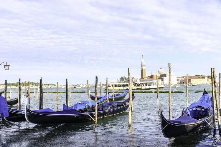 Gandolas on Lido's shore Architecture Building Exterior Cloud - Sky Gondola - Traditional Boat Mode Of Transport Transportation Travel Destinations Venice Water First Eyeem Photo