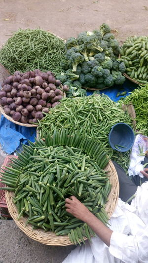 Low Section Of Vendor Selling Vegetables