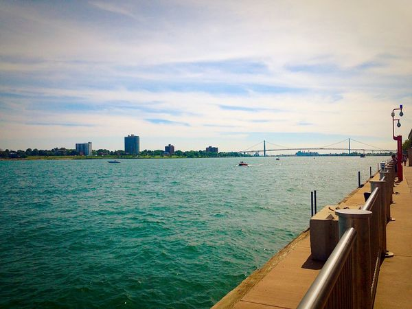 Taken along the Detroit river front in the summer time. Ambassador Architecture Bridge Detroit Hotel Journey Michigan Outdoors River Summer Water Waterfront