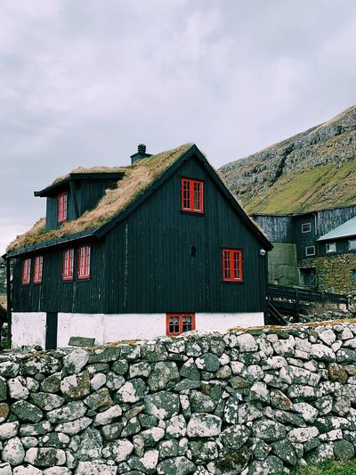 View of red and house against sky