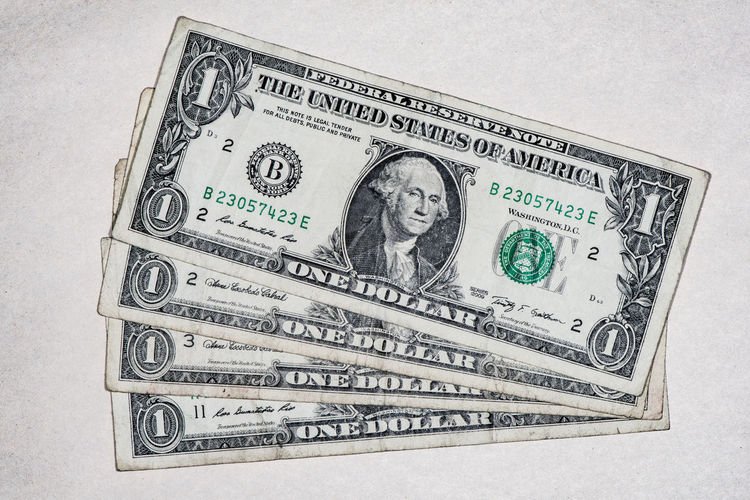 Four, used dollar notes on a tainted grey background America Capitalism Cash Dollar Bill Dollar Notes Dollars Money No People One Dollar  USA Pay Taxes Revenue