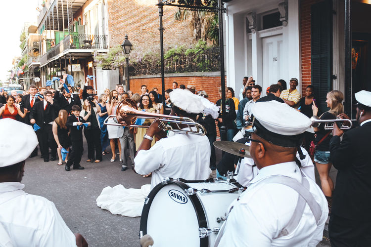 A brass band plays for newly weds in New Orleans on the street with a large crowd of people. - IG: @LostBoyMemoirs Streetwise Photography Streetphotography Street Photography People People Watching people and places Crowd Large Group Of People Group Of People Togetherness Uniform Lifestyles Brass Band New Orleans Band Happiness The Art Of Street Photography