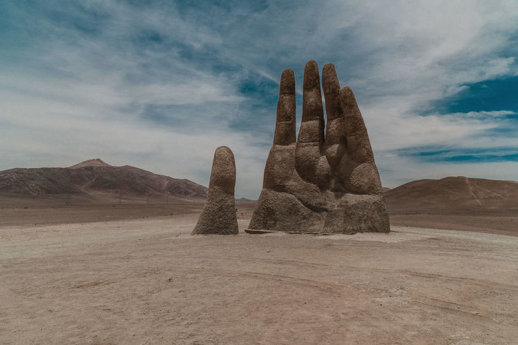Rock formations at desert against sky