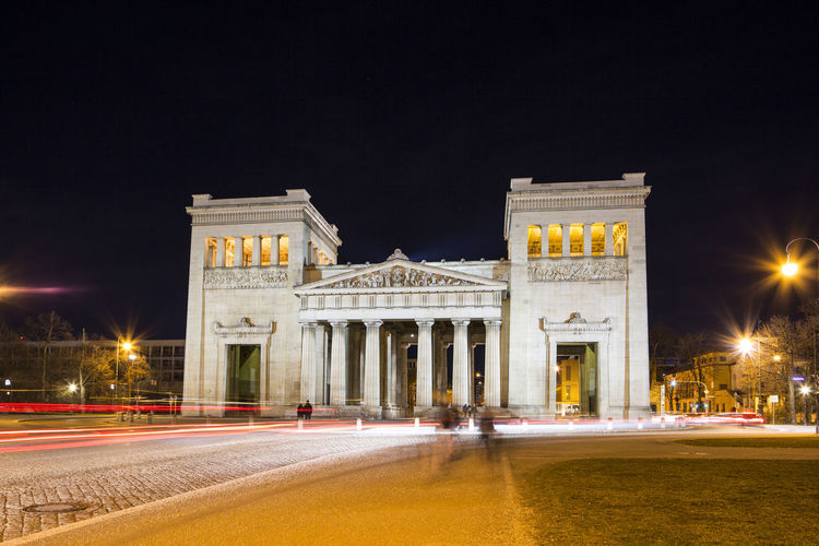 A long exposure motion blurred view of the Königsplatz in Munich, Germany at night. Night Illuminated Architecture Motion Built Structure Travel Destinations Blurred Motion Long Exposure History The Past City Building Exterior Street Light Street Light Trail Sky Speed Nature Outdoors Neo-classical München Germany Königsplatz München Königsplatz City At Night