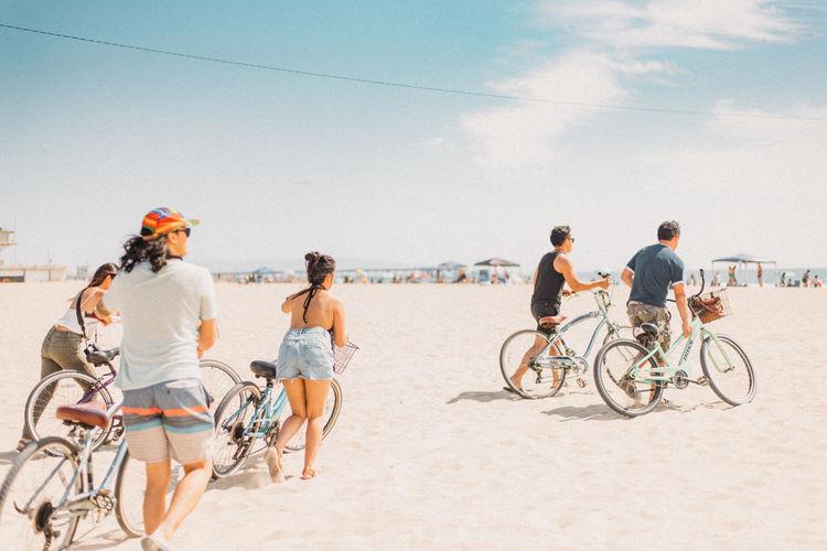 Men riding bicycle