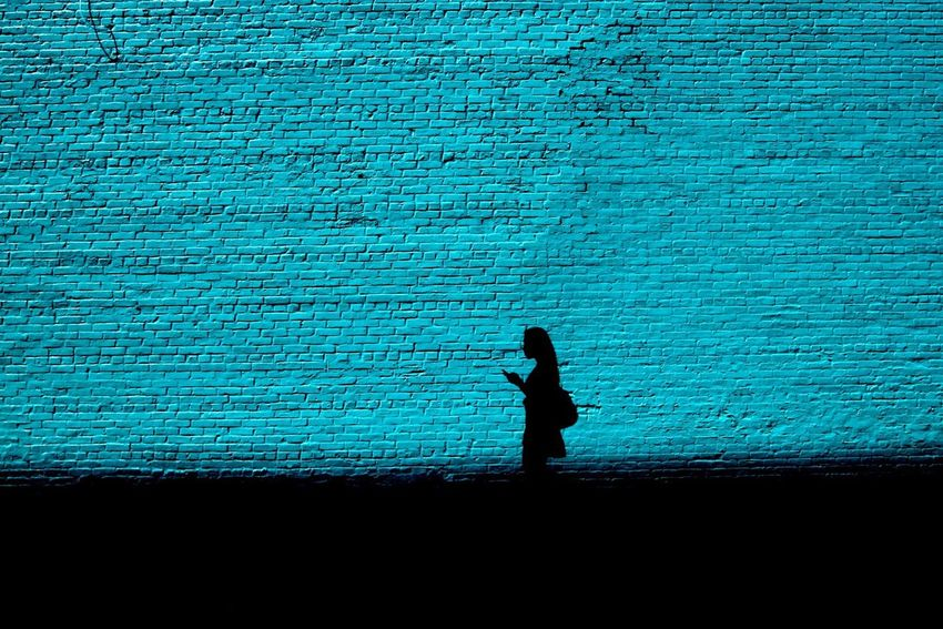 Check This Out Silhouette Blue Shadow Brick Streetphotography NYC Contrast Passing By Strideby
