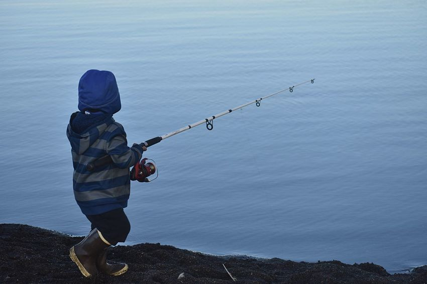Learning how to fish Copy Space Alaska Arctic One Person Winter Nature Full Length Cold Temperature Childhood Men Leisure Activity Fishing Day Clothing Side View Water Real People Standing Lifestyles Beauty In Nature Warm Clothing Activity Outdoors