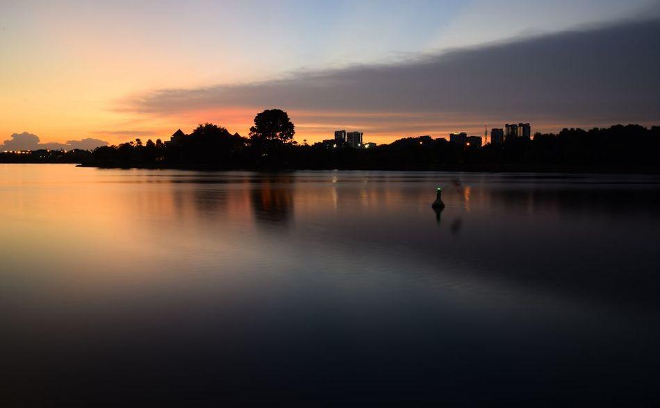 Sunset view at Putrajaya lake. Water Tree Sunset Lake Silhouette Full Length Reflection