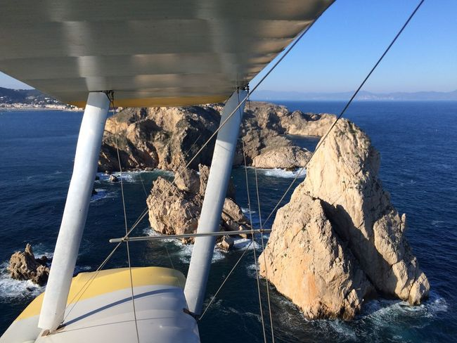 Biplane Flying Islas Medas Outdoors Rock Rock - Object Rock Formation Scenics - Nature Sea Water