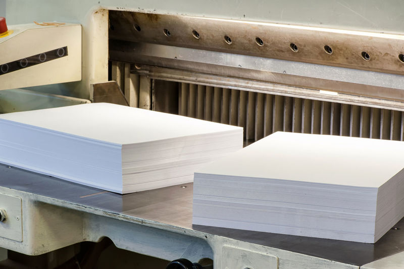 Close-up of blank papers stack on table
