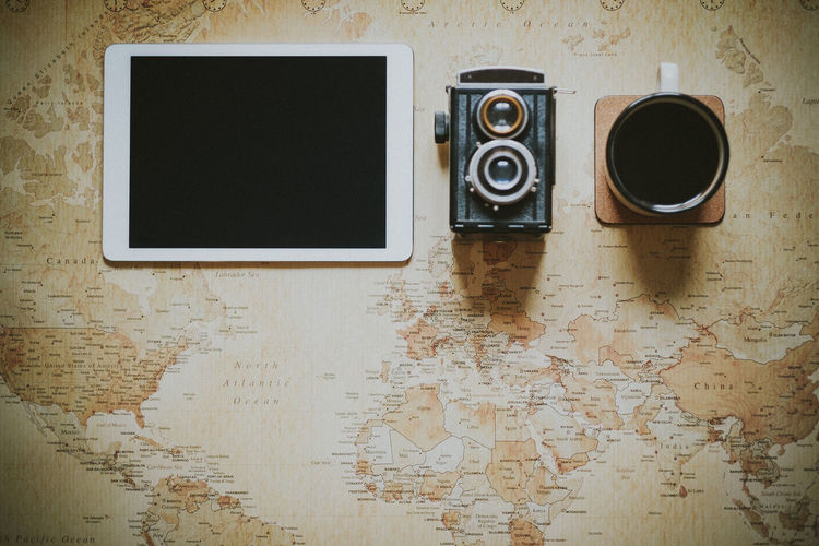 Camera Coffee Copy Space Planning Tablet Travel Travel Photography Camera - Photographic Equipment Coffee Coffee Cup Digital Nomad Directly Above Indoors  No People Photography Themes Retro Styled Still Life Technology Vintage Camera
