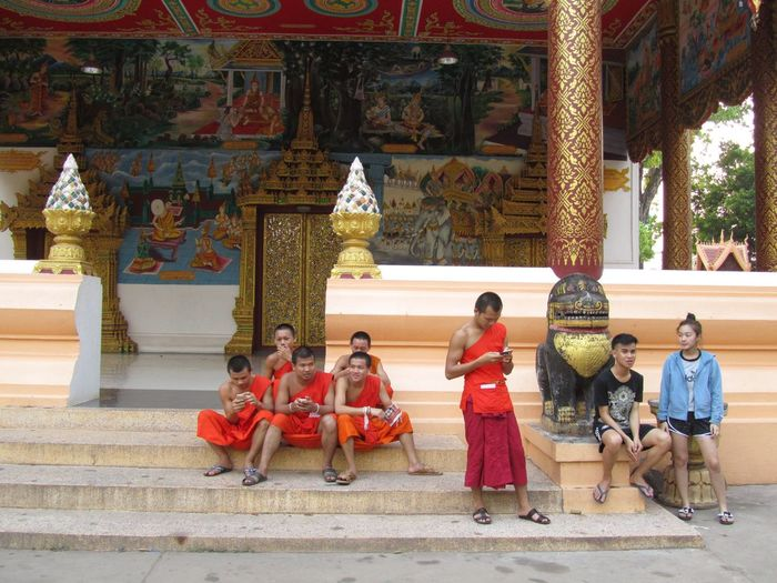 Mobile Conversations Religion and social media Photooftheday Week On Eyeem Young Men Monks at a Temple in Laos capital I came across this interesting scene. Monks focused on their phones