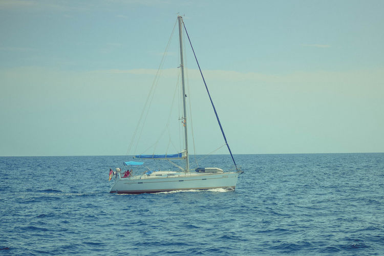 Sea Transportation Nautical Vessel Water Mode Of Transportation Sailboat Sky Horizon Horizon Over Water Waterfront Sailing Beauty In Nature Scenics - Nature Nature Travel Mast Day Pole Outdoors Luxury Yacht Copy Space
