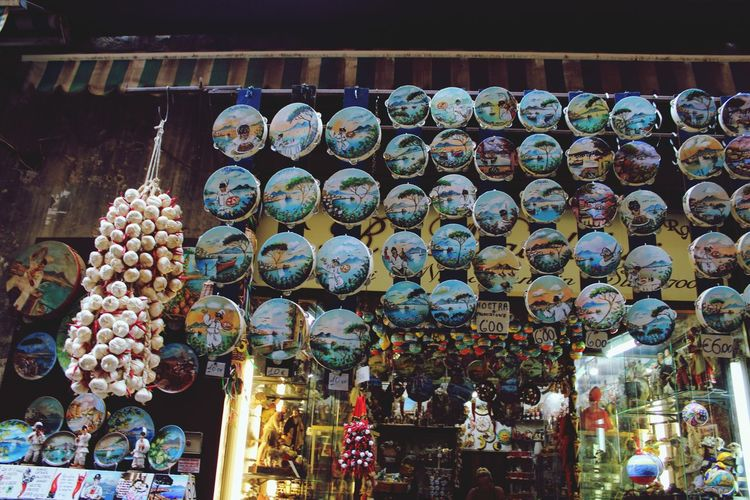 Streets of Napoli #urbanana: The Urban Playground Fullofcolors Tamburello Urbanphotography Naples Urban Landscape Music Urban Scene Streetsofnaples Streetphotography Italy Landscape Hanging Display Stall Shop Market Stall Various Market For Sale