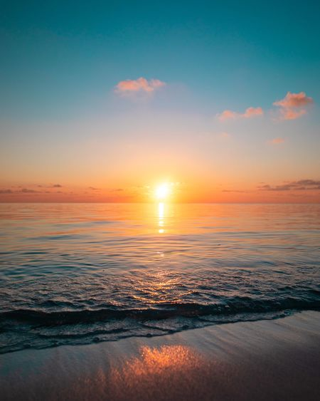 Sunset Calm Sunset Sky Water Beauty In Nature Sea Scenics - Nature Tranquility Cloud - Sky Land Horizon Over Water Idyllic Tranquil Scene Beach Horizon Outdoors No People Nature Sun Orange Color Sunlight