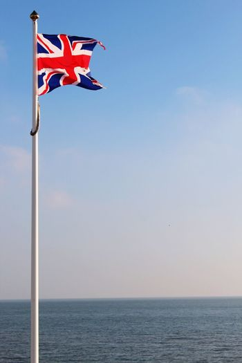 Flag Patriotism Clear Sky No People Pole Sea Outdoors Day Sky Post Beach Freezing Cold Freshness Water Breezy Day Union Jack