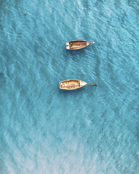 Drone  EyeEm Best Shots Beauty In Nature Blue Day Floating Floating On Water Food And Drink High Angle View Mode Of Transportation Nature Nautical Vessel No People Outdoors Rippled Scenics - Nature Sea Tranquility Transportation Turquoise Colored Water Waterfront