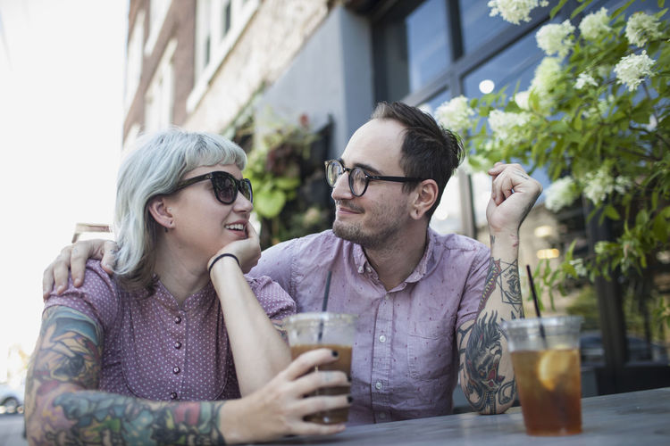 Young couple sitting with drink