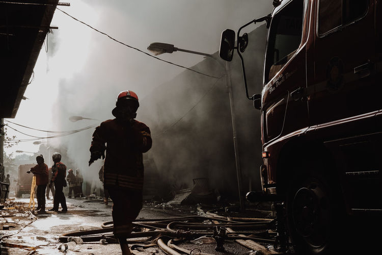 firefighter Real People Men Smoke - Physical Structure Outdoors The Photojournalist - 2019 EyeEm Awards Firefighter Occupation Accidents And Disasters