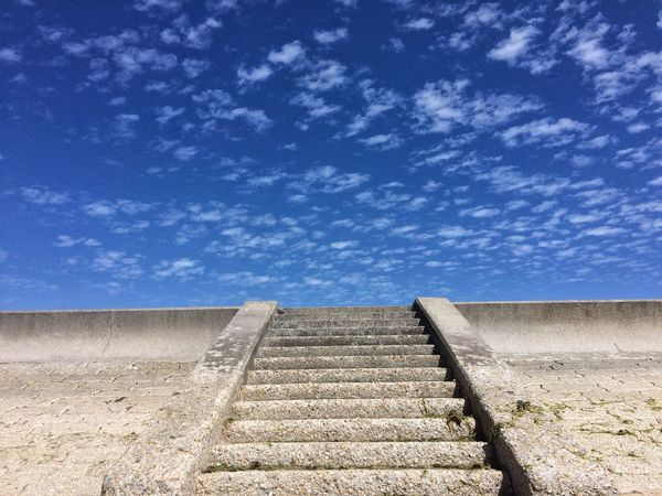 Stairs at sea side Sky Cloud - Sky Nature Day No People Blue Low Angle View Architecture Built Structure Sunlight Scenics - Nature Wall Outdoors Tranquil Scene Wall - Building Feature