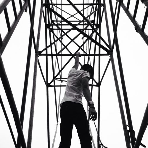 Last hope. Breathing Space The Week Of Eyeem Monochrome Photography Blackandwhite One Person Rear View Real People Low Angle View Men Casual Clothing Day Standing Lifestyles Technology Full Length Architecture Modern One Man Only Outdoors Sky Adult Only Men People Adults Only