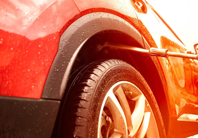 Close-up of wet red car