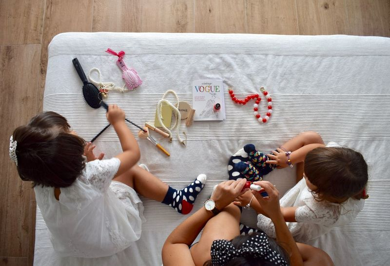 Girl Power Having Fun Mothership Painting Nails Vogue Child Childhood Day Directly Above Family Time Freshness Girls High Angle View Indoors  Mom And Daughters People Playing With Mommy Preparation  Real People Sitting Togetherness