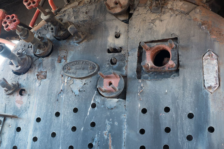 Old abandoned rusty steam locomotive interior Old Abandoned Rusty Steam Locomotive Interior Locomotive Engine Steam Metal Hole Day Close-up Indoors  Rusty No People High Angle View Weathered Equipment Circle Industry Geometric Shape Shape Pattern Full Frame Body Part