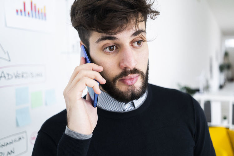 Portrait of young man using smart phone