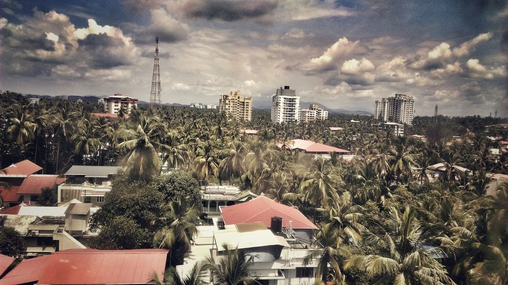 When you are in Kerala (India), get used to of this view. View EyeEm Selects Built Structure Building Exterior Roof Tree City No People Cityscape