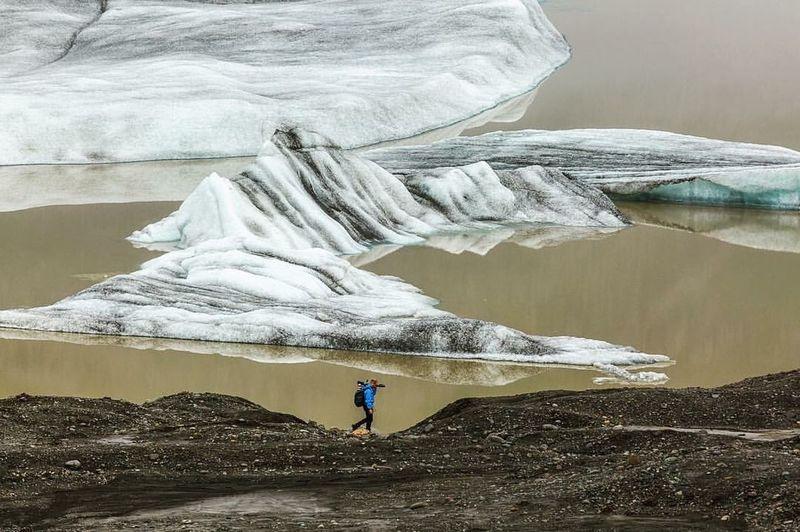 Full length of man on rock against mountains