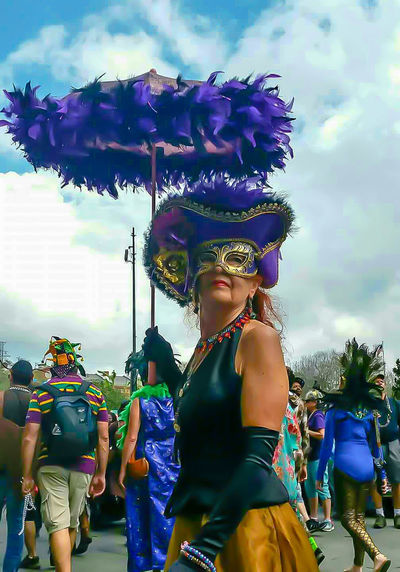 Outdoors Adults Only Young Adult Adult Sky Day People Performance Costume Mardi Gras Decoration Carnival Costume Jewelry Feathers Umbrella Mask Street Photography Celebration Party People Festive Clothing Bright Colors Mask - Disguise Disguise Disguised