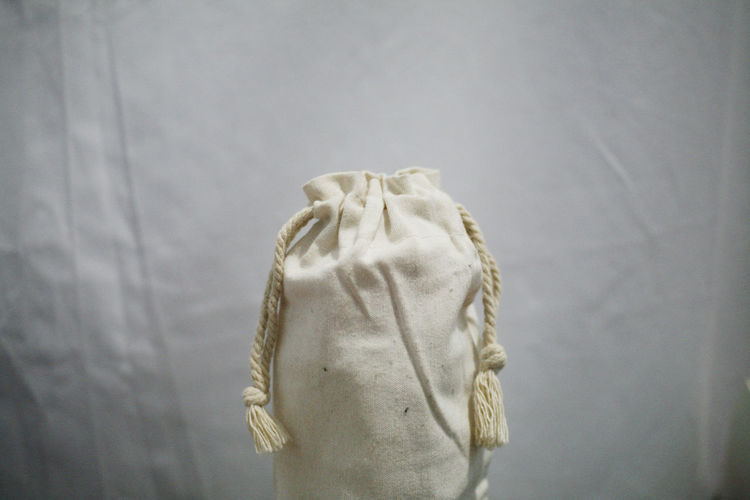 Close-up view of white bag against wall