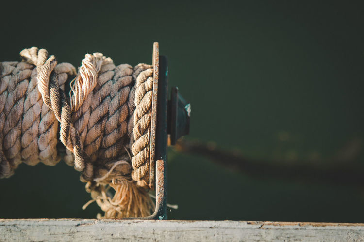 Close-Up Of Rope Rolled Up On Pulley At Lake