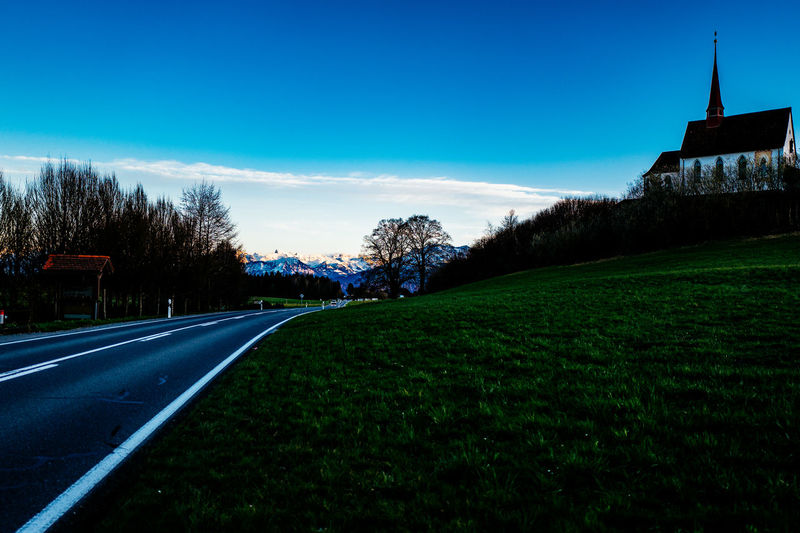 Architecture Blue Building Exterior Built Structure Clear Sky Cloud Country Road Field Gormund Grass Grassy Kapelle Landscape Nature No People Outdoors Road Sky Street The Way Forward Transportation Tree