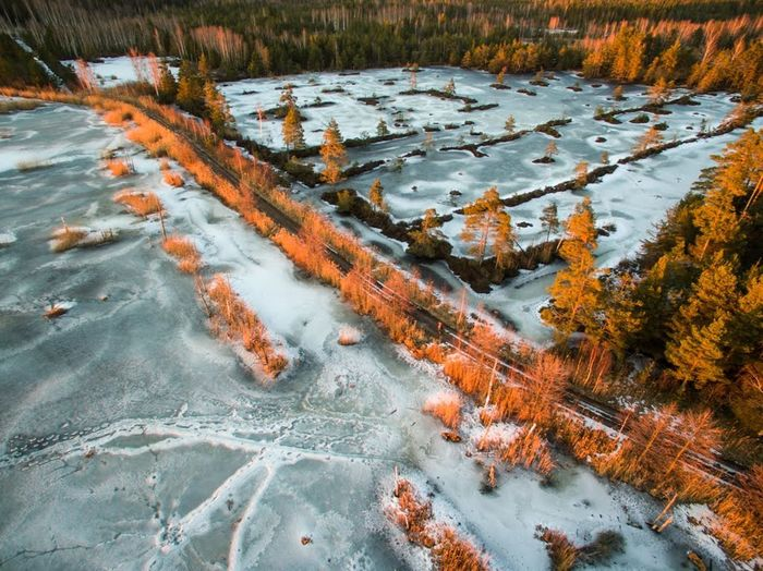 Sunset (golden hour) over the national park at winter Ice Road Beauty In Nature Dronephotography Forest Golden Hour Landscape Nature No People Outdoors Scenics Sunset Tree Wilderness Area Winter