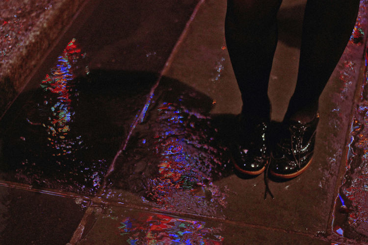 Rainy Day, 2018 Low Section Human Leg Human Body Part Body Part Shoe One Person Real People Lifestyles High Angle View Night Standing Water Indoors  Human Foot Wet Unrecognizable Person Leisure Activity Limb Flooring Nightlife Human Limb Tiled Floor New York NYC Shoes Rain Wet Floor City Lights