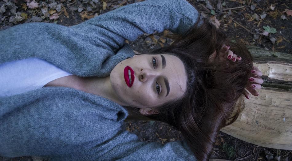 Portrait Of Woman Lying In Forest