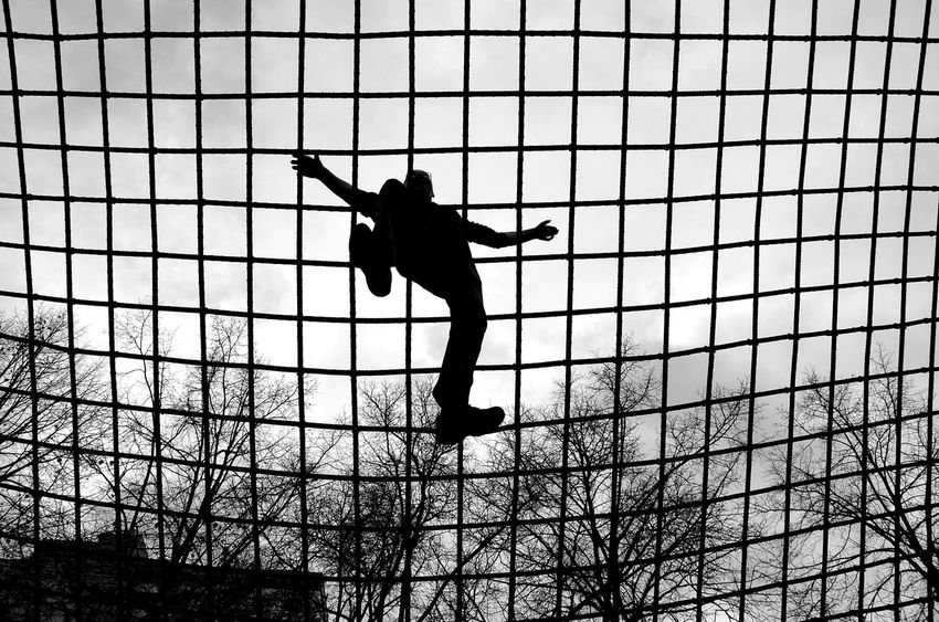Over The Top Silhouette Full Length One Person EyeEm Best Shots Art Photography Streetphotography Networking Network Bnw_friday_eyeemchallenge Bnw_life Berlin Photography Minimalism_bw Noir Et Blanc Monochrome Photographie Bnw Photography Over My Head EyeEm Gallery Mains Grid Steel Cable Pattern Quader Spectacular View Black And White Friday EyeEm Ready