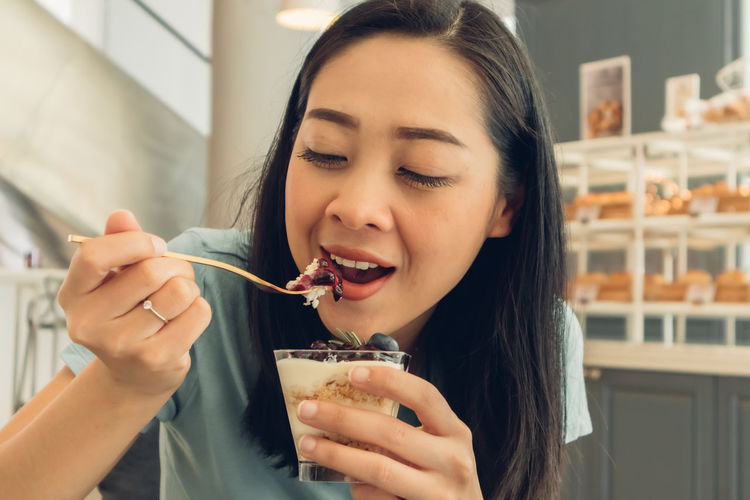 Portrait of woman eating food