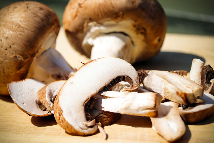 Sliced mushrooms. Mushrooms Animal Shell Animal Wildlife Close-up Day Edible Mushroom Focus On Foreground Food Food And Drink Fungus Group Of Objects Health Healthy Indoors  Mushroom Nature No People Selective Focus Still Life Sunlight Vegetable Vegetables Wood - Material