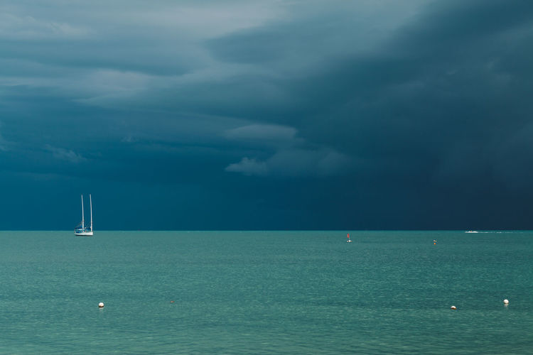 Water Sea Sky Scenics - Nature Cloud - Sky Beauty In Nature Nautical Vessel Horizon Over Water Horizon Waterfront Nature No People Transportation Tranquil Scene Day Mode Of Transportation Idyllic Tranquility Sailboat Outdoors Turquoise Colored